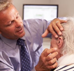 Doctor Checking Patients Hearing